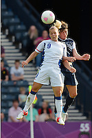 Glasgow, Scotland - July 25, 2012: Abby Wambach wins a header over Eugenia le Sommer during the US women's soccer team's win against France, 4-2.