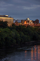 Science Teaching and Student Services building and the Weisman Art Museum at dusk on the University of Minnesota East Bank campus situated above the Mississippi River.