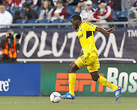 Columbus Crew midfielder Tony Tchani (6) brings the ball forward. In a Major League Soccer (MLS) match, the New England Revolution tied the Columbus Crew, 0-0, at Gillette Stadium on June 16, 2012.