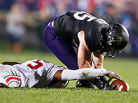 Ohio State Buckeyes quarterback Braxton Miller (5) and Northwestern Wildcats linebacker Collin Ellis (45) chase a loose ball during Saturday's NCAA Division I football game at Ryan Field in Evanston on October 5 2013. (Barbara J. Perenic/The Columbus Dispatch)