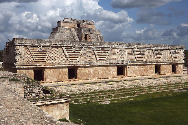 The Nunnery Quadrangle, East Building, 900-1000 AD, with the Temple of the Magician in the distance, Puuc architecture, Uxmal late classical Mayan site, Yucatan, Mexico Picture by Manuel Cohen
