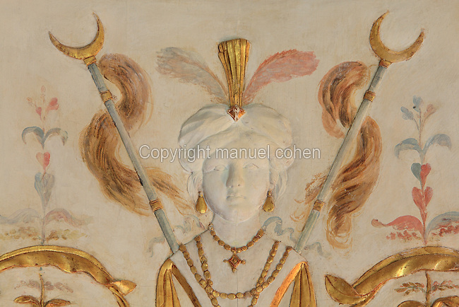 "Frescoes and carved stuccoes depicting a figure with turban, earrings, feathers and collars, probably a eunuch, Turkish Boudoir, redesigned in 1777 for Marie Antoinette, by architect Richard Mique, Chateau de Fontainebleau, France. The decoration is the achievement of the brothers Rousseau, and the furniture dates to the period of the First Empire, with precious textile work done by Jacob-Desmalter for Empress Josephine. Including a small bedroom, mirrors, and curtains raised by pulleys, this exceptional ensemble has been restored in 2014 thanks to the support of INSEAD and the generosity of subscribers of sponsors belonging to the group ""Des Mécènes pour Fontainebleau"". Its opening to the public is schedule for Spring 2015. Picture by Manuel Cohen"