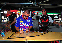Jun. 17, 2011; Bristol, TN, USA: NHRA top fuel dragster driver Shawn Langdon sign autographs during qualifying for the Thunder Valley Nationals at Bristol Dragway. Mandatory Credit: Mark J. Rebilas-