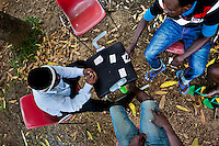 Ghanese immigrants, heading to the southern U.S. border, play cards while being held in the detention center in Metetí, Darién, Panama, 31 January 2015.