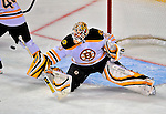 22 April 2009: Boston Bruins' goaltender Tim Thomas makes a second period save against the Montreal Canadiens at the Bell Centre in Montreal, Quebec, Canada. The Canadiens, down three games to none at the start of play, fell to the visiting Bruins 4-1. The Habs were eliminated from the Stanley Cup playoffs in a four-game sweep by the Division winning Bruins. ***** Editorial Sales Only ***** Mandatory Credit: Ed Wolfstein Photo