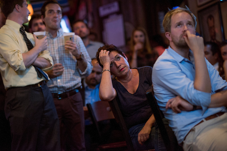 UNITED STATES - OCTOBER 19: Margie van Esch, center, and other guests attend a watch party for the last presidential debate between Donald Trump and Hillary Clinton at Capitol Lounge on Pennsylvania Avenue, SE, October 19, 2016. (Photo By Tom Williams/CQ Roll Call)