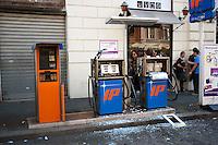 Roma  15 Ottobre 2011.Manifestazione contro la crisi e l'austerità.Un distributore di benzina distrutto.