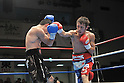 (L-R) Shigetaka Ikehara, Takuya Kogawa,.JANUARY 26, 2012 - Boxing :.Takuya Kogawa in action against Shigetaka Ikehara in the fourth round during the vacant Japanese flyweight title bout at Korakuen Hall in Tokyo, Japan. (Photo by Hiroaki Yamaguchi/AFLO)