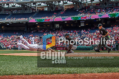 14 May 2016: Washington Nationals infielder Anthony Rendon dives home to score during the first game of a double-header against the Miami Marlins at Nationals Park in Washington, DC. The Nationals defeated the Marlins 6-4 in the afternoon matchup.  Mandatory Credit: Ed Wolfstein Photo *** RAW (NEF) Image File Available ***