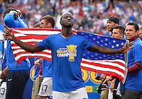 Chicago, IL - Sunday July 28, 2013:   USMNT forward Eddie Johnson (26) celebrates by waving the American flag to fans after the USMNT defeated Panama by the score of 1-0 in the CONCACAF Gold Cup Finals soccer match between the USMNT and Panama, at Soldier Field in Chicago, IL.
