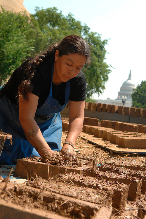 Juanita Morales Escalante makes bricks of mud and hay for an outdoor sculpture near the National Museum of the American Indian, by artist Nora Naranjo-Morse.