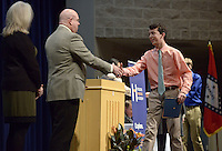 NWA Democrat-Gazette/BEN GOFF @NWABENGOFF<br /> Adam Siwiec shakes hands with Dr. Lance Arbuckle, principal of Rogers New Technology High School, as he walks the stage to receive his certificate of enrollment Sunday, Feb. 12, 2017, during an induction ceremony for the inaugural class of the Rogers Honors Academy at Rogers High School.