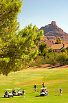 USA, Arizona, Fountain Hills. Carts and golfers play the course at Fountain Hills, with Red Mountain in the background.