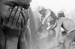 Menino sente-se sufocado com fumaça dos fornos da carvoaria. Mato Grosso do Sul, MS - 1988..Boy is suffocated with smoke of the ovens of the coal pit. Mato Grosso do Sul, BAD - 1988.