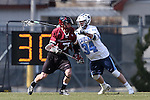 14 February 2015: UMass's Gianni Bianchin (7) and North Carolina's Jack Lambert (34). The University of North Carolina Tar Heels hosted the University of Massachusetts Minutemen in a 2015 NCAA Division I Men's Lacrosse match. UNC won the game 20-8.