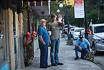 Tanner Horton talks with Kenny Fugate outside the auction house in downtown Hyden, Ky., on Thursday, October 10, 2013. Horton, Fugate, and Lowell Cornet (right) play bluegrass music together at weekly jam sessions. Photo by Emily Wuetcher