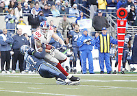 27 Nov 2005:  New York Giants tight end Jeremy Shockey is brought down by Seattle Seahawks corner back Jordan Babineaux after catching a Eli Manning pass for a first down at Quest Field in Seattle, WA.