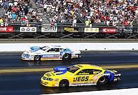 Jul. 28, 2013; Sonoma, CA, USA: NHRA pro stock driver Jeg Coughlin Jr (near) races alongside Allen Johnson during the Sonoma Nationals at Sonoma Raceway. Mandatory Credit: Mark J. Rebilas-