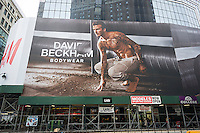 A giant blow-up of soccer star David Beckham in his branded skivvies promoting his line of underwear decorates the side of a future H&M in New York, directly across from Macy's, seen on Sunday, January 26, 2014.  H&M is once again carrying the soccer athlete's underwear collection as it did in 2012. The promotion for the line of undies will officially kick-off with a Super Bowl commercial featuring the well-exposed athlete. The store has also featured mass-market fashion by designers Versace, Karl Lagerfeld, Stella McCartney among others.  (© Richard B. Levine)