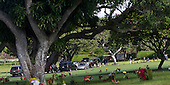United States President Barack Obama's motorcade is seen at the National Memorial Cemetery of the Pacific at Punchbowl in Honolulu, Hawaii, to visit the grave of his maternal grandfather, Stanley Dunham, Sunday, January 1, 2012. President Obama is in Hawaii with his family for a low-key vacation..Credit: Kent Nishimura / Pool via CNP