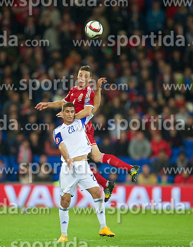13.10.2014, City Stadium, Cardiff, WAL, UEFA Euro Qualifikation, Wales vs Zypern, Gruppe B, im Bild Wales' James Chester in action against Cyprus' Pieros Sotiriou // 15054000 during the UEFA EURO 2016 Qualifier group B match between Wales and Cyprus at the City Stadium in Cardiff, Wales on 2014/10/13. EXPA Pictures &copy; 2014, PhotoCredit: EXPA/ Propagandaphoto/ David Rawcliffe<br /> <br /> *****ATTENTION - OUT of ENG, GBR*****