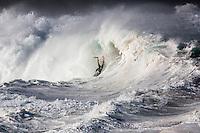 A bodyboarder rides a Waimea Shorebreak wave, North Shore, O'ahu.