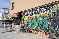A mural on the side of a deli in the Bushwick neighborhood of Brooklyn in New York on Saturday, April 19, 2014. The neighborhood is undergoing gentrification changing from a rough and tumble mix of Hispanic and industrial to a haven for hipsters, forcing many of the long-time residents out because of rising rents.. (© Richard B. Levine)
