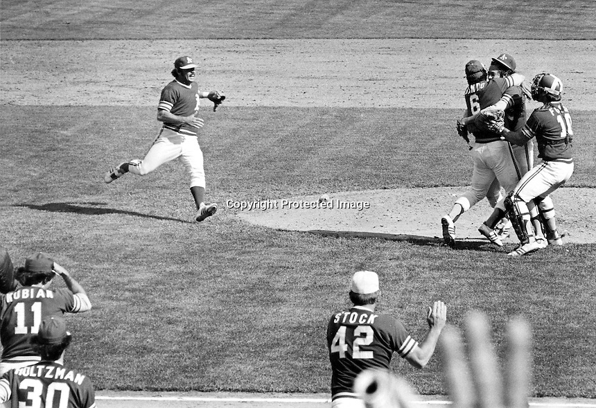 "A's win the American League Pennant 1973.,wining pitcher Jim ""Catfish""Hunter is mobbed by Sal Bando and Ray Fosse as Dick Green comes from the left. The A;s defeated the Baltimore Orioles.(photoby Ron Riesterer)"