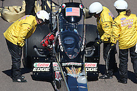 Feb. 24, 2013; Chandler, AZ, USA; NHRA Safety Safari checks out top fuel dragster driver Brittany Force during the Arizona Nationals at Firebird International Raceway. Mandatory Credit: Mark J. Rebilas-