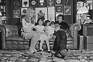 """March 1971, New Jersey, USA. Paul Anka and daughters at home. Paul Anka (b. July 30, 1941) is a Canadian singer, songwriter and actor who became famous with the hit songs """"Diana"""", """"Lonely Boy"""" and """"Put Your Head on My Shoulder"""", as well as famously wrote the well-known theme music for The Tonight Show Starring Johnny Carson and one of Tom Jones's biggest hits, """"She's a Lady"""". Image by © JP Laffont"""