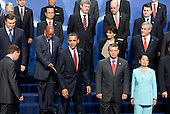 United States President Barack Obama arrives for a group photo with the heads of delegations attending the Nuclear Security Summit at the Washington Convention Center in Washington, D.C., U.S., on Tuesday, April 13, 2010. Ukraine's agreement to relinquish its entire stockpile of highly enriched uranium gave Obama the first concrete result for a summit he convened on securing the world's atomic material. .Credit: Andrew Harrer / Pool via CNP