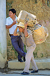 Man Carrying Baskets