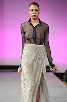 "Model walks runway in an outfit from the ALICAT Avril Lemieux 2012 ""Stolen Loot"" collection, during Couture Fashion Week New York Fall 2012."