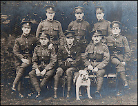BNPS.co.uk (01202 558833)<br /> Pic: PhilYeomans/BNPS<br /> <br /> A much more world weary and decorated Ln Cpl William Taylor at the end of the war with comrades from the Herts Regt and bulldog mascot.<br /> <br /> Saved by pictures of his loving family...<br /> <br /> An amazing tale of a heroes lucky survival through the entire First World War has been uncovered after his family revealed his remarkable tale to a local history group.<br /> <br /> Photos of loved ones that saved a soldier's life by stopping a piece of shrapnel aimed for his heart have come to light - complete with the holes the fragment left behind.<br /> <br /> Private William Taylor kept the nine pictures of his family in his wallet in his breast pocket during the entire four years of World War One.<br /> <br /> In a remarkable quirk of fate he survived a battle which left three quarters of his regiment dead or injured thanks to the stack of photos which took the impact of a shell blast.<br /> <br /> The projectile pierced the outer layer of his leather wallet and perforated eight of the nine photos.<br /> <br /> Luckily, the last picture of his younger sister Lilly stopped the fragment from going any further.