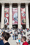 People find the steps of the National Archives a good place to sit and take in some of the Rally to Restore Sanity and/or Fear, a couple blocks away on the National Mall in Washington, DC.