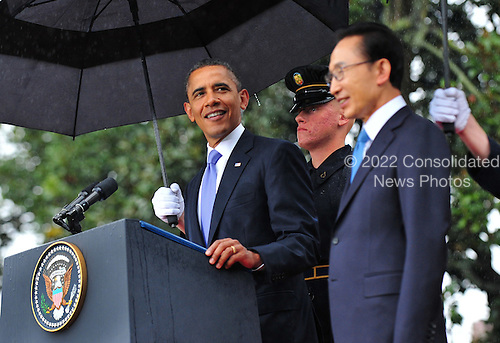 United States President Barack Obama and South Korean President Lee Myung-bak stand during an arrival ceremony on the South Lawn of the White House in Washington, D.C. on Thursday, October 13, 2011.  .Credit: Kevin Dietsch / Pool via CNP