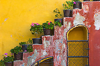 """The wonderful staircases of San Miguel de Allende, which with its countless colorful facades and doors, is a city and municipality located in the far eastern part of the state of Guanajuato in central Mexico. It is 274 km from Mexico City and 97 km from the state capital of Guanajuato. Historically, the town is important as the birthplace of Ignacio Allende, whose surname was added to the towns name in 1826, as well as the first municipality declared independent of Spanish rule by the nascent insurgent army during the Mexican War of Independence...However, the town waned during and after the war, and at the beginning of the 20th century, was in danger of becoming a ghost town. Its Baroque/Neoclassical colonial structures were """"discovered"""" by foreign artists who moved in and began art and cultural institutes such as the Instituto Allende and the Escuela de Bellas Artes. This gave the town a reputation, attracting artists such as David Alfaro Siqueiros, who taught painting...This attracted foreign art students, especially former U.S. soldiers studying on the G.I. Bill after the Second World War. Since then, the town has attracted a very large number of foreign retirees, artists, writers and tourists, which is shifting the areas economy from agriculture and industry to commerce catering to outside visitors and residents...The main attraction of the town is its well-preserved historic center, filled with buildings from the 17th and 18th centuries. This and the nearby Sanctuary of Atotonilco have been declared World Heritage Sites."""