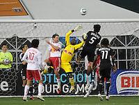 New York Red Bulls goalkeeper Bouna Coundoul (18) goes up to safe the play.  The New York Red Bulls defeated DC United 4-0, at RFK Stadium, Thursday April 21, 2011.