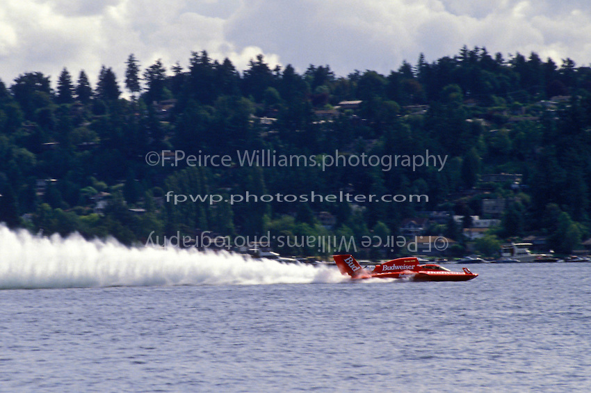 "Frame 1: Chip Hanauer speeds into turn one in the U-1 ""Miss Budweiser T-3"" where the right sponson lifts skyward and the boat blows over. Hanauer escaped injury in the accident."