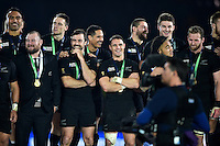 New Zealand players look on on the winners' podium after the match. Rugby World Cup Final between New Zealand and Australia on October 31, 2015 at Twickenham Stadium in London, England. Photo by: Patrick Khachfe / Onside Images
