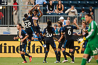Sheanon Williams (25) of the Philadelphia Union celebrates scoring with Raymon Gaddis (28) during the first half against the Columbus Crew during a Major League Soccer (MLS) match at PPL Park in Chester, PA, on June 5, 2013.