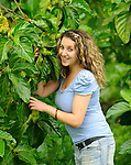Noni plants with a model<br /> El Salvador