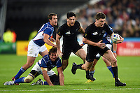 Beauden Barrett of New Zealand goes on the attack. Rugby World Cup Pool C match between New Zealand and Namibia on September 24, 2015 at The Stadium, Queen Elizabeth Olympic Park in London, England. Photo by: Patrick Khachfe / Onside Images