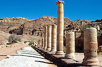 Jordan. Petra. The archeological site is part of the UNESCO world heritage project.  The Nabataeans were an arabian industrious tribe which settled down in southern Jordan 2000 years ago. Petra is located at the bottom of a spectacular deep gorge surrounded by mountains. At the end of columns alley, the various king tombs are  carved in the mountains. © 2002 Didier Ruef