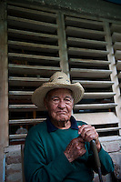 Rural scene Holguin Province, Cuba. 9-12-10  The village of Bajo bel Cerro. Retired farmer Cruz Parra.