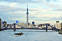 November 13, 2011, Tokyo, Japan - Tokyo Sky looms over Tokyos Sumida River on Sunday, November 13, 2011. The 634-meter-high terrestrial digital broadcasting tower will be recognized by Guiness World Records as the worlds tallest senf-standing tower in a ceremony on Thursday. (Photo by Masahiro Tsurugi/AFLO) [2910] -mis-