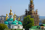 Travel stock photo of The Mother of God Christmas Church near the far caves and a Bell tower in scaffolding being restored on the territory of Kievo-pecherskaya lavra - Kiev pechersk lavra - Cave monastery in Kiev Ukraine Eastern Europe Architecture in Ukrainian baroque architectural style Largest monastery in Russia Horizontal orientation May 2007