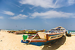 Colorfully-painted boats line the beach of Yoff, a fishing village 30 minutes outside of Senegal's capital city of Dakar.
