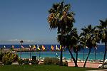 Flags flying over Playa de Los Amadores, Puerto Rico, Gran Canaria,Canary Islands, Spain