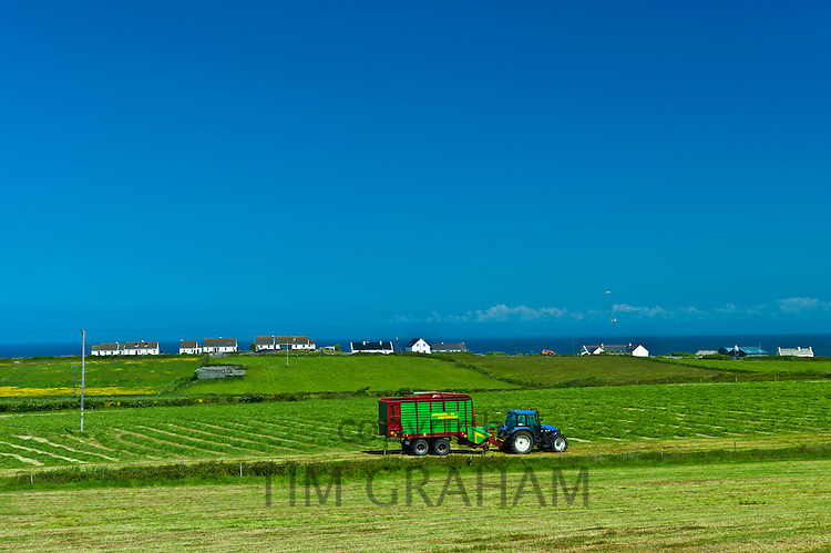 Tractor and trailer at work in field near Doonbeg, County Clare, West of Ireland